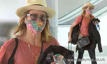 Robin Wright masks up for solo flight out of LAX... after star-studded Princess Bride reunion