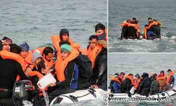 Migrants packed into tiny dinghy desperately bail out water as they try to get across Channel