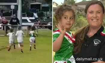 Hilarious moment little girl speeds past eight footy players to score a try - but forgets to stop