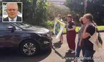 Climate change protester blocks Scott Morrison's security car in Port Kembla, NSW