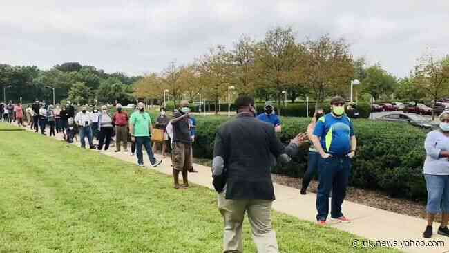 Elbow Bumps and Masks on Display as Long Lines Form for First Day of Early Voting in Virginia