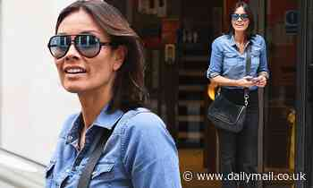 Melanie Sykes nails 70s chic in denim shirt and black trousers as she exits BBC Radio 2 studios