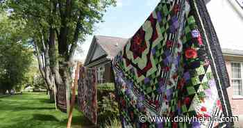 Quilts are displayed outdoors in Libertyville senior community