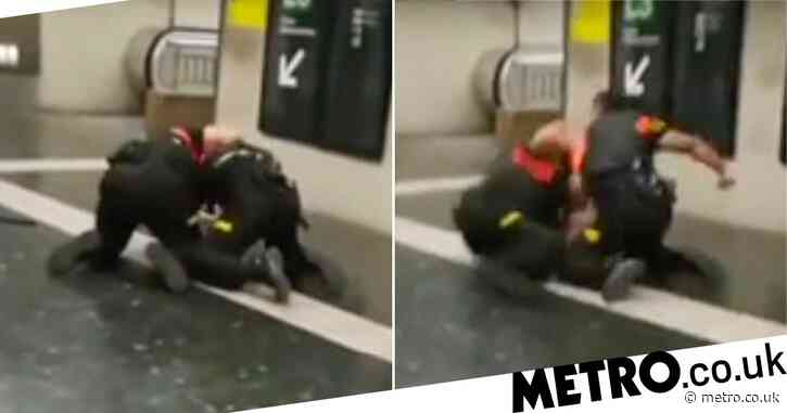 Security guard filmed 'trying to strangle colleague' at train station