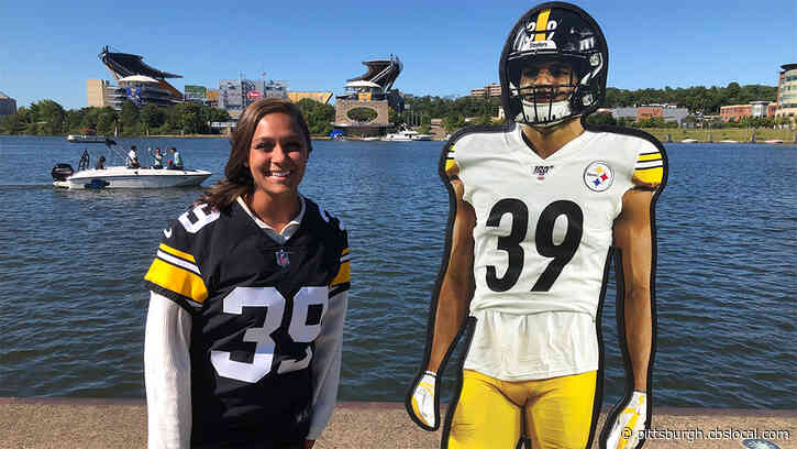 Steelers Fans Pose With Lifesize Cutouts Of Players