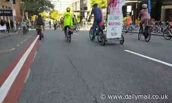 Climate activist bring peak hour traffic in Brisbane to a standstill by deliberately cycling slow