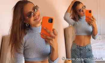 Brad Pitt's girlfriend Nicole Poturalski flaunts her abs in a blue crop top