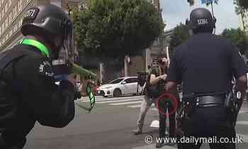 Bodycam footage shows LAPD cop firing a foam-covered round at a BLM protester's groin