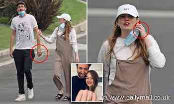 Emma Stone and her fiance are spotted wearing matching bands on their ring fingers