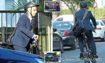 Sadiq Khan rides to work on trendy e-bike (while his security team follow in a Range Rover)