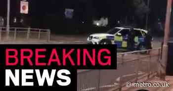 Armed police surround pub with 20 customers trapped inside