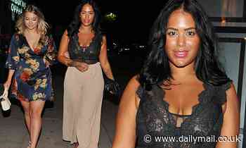Malin Andersson displays her famous curves in a plunging lace top for a night out in Manchester