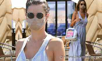 Alessandra Ambrosio shows off her figure in a blue sundress as she arrives for a skincare session