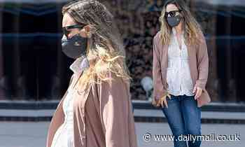 Rachel McAdams masters maternity chic with pretty smock blouse and jeans as she runs errands in LA