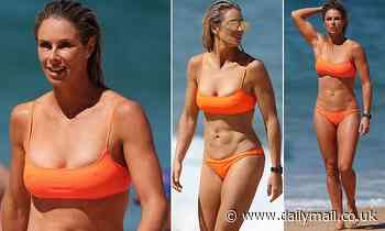 Candice Warner, 35, flaunts her incredible bikini body at the beach