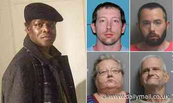 Four people are charged after black man's burning corpse is found in a ditch