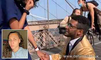 Proposal on Brooklyn Bridge doesn't quite go to plan as photographer gets whacked by cyclist