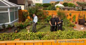 Parents arrested over suspected murder of son astonished as police search garden