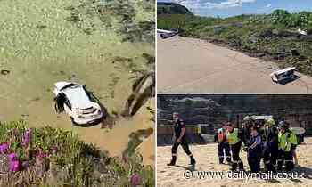 Driver smashes through a barrier and plunges 20 metres down the cliff face and onto the beach below