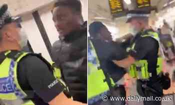 Shocking moment police officers drag passenger off busy London train for refusing to wear face mask
