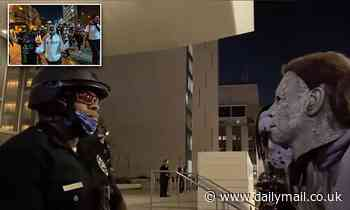 Agitators at a BLM rally in Los Angeles scream profanities at a black police officer