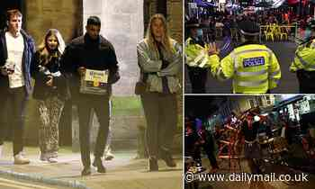 Pub-goers head home after being turfed out across England as 10pm curfew begins