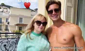 Rebel Wilson poses with shirtless boyfriend Jacob Busch