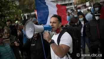 In France, the pandemic deepens the political divide as death toll continues to rise