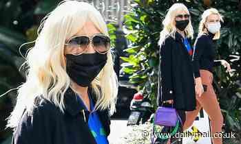 Donatella Versace cuts a glamourous figure as she attends Milan Fashion Week