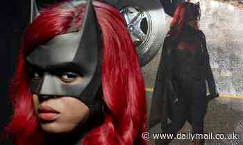 Javicia Leslie flashes a bright smile as she is seen for the first time in her full Batwoman suit