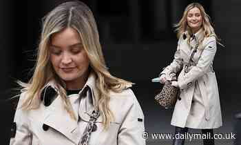 Laura Whitmore looks casually chic in a trench coat and leather leggings