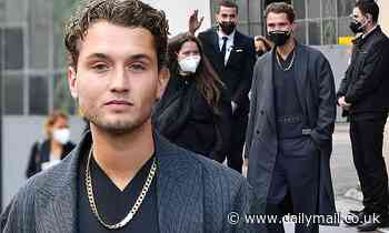 Rafferty Law looks dapper in all-black with a gold chain as he attends the Valentino show