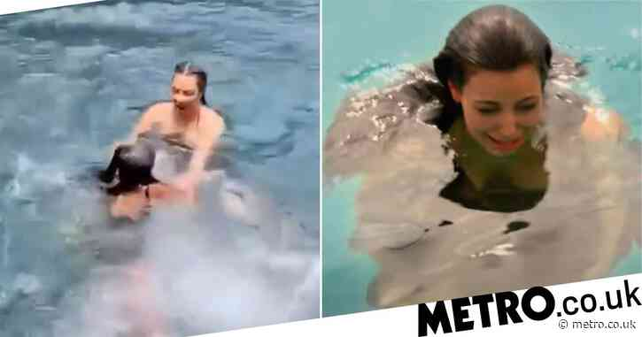 Kim Kardashian reminds fans of iconic KUWTK episode where she lost her diamond earring as she leaps into lagoon
