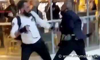 Boxing bout in the Bull Ring: Moment Selfridges guard and shopper trade brutal blows