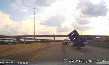 Trailer flips over on bypass in Texas as lucky driver escapes unscathed
