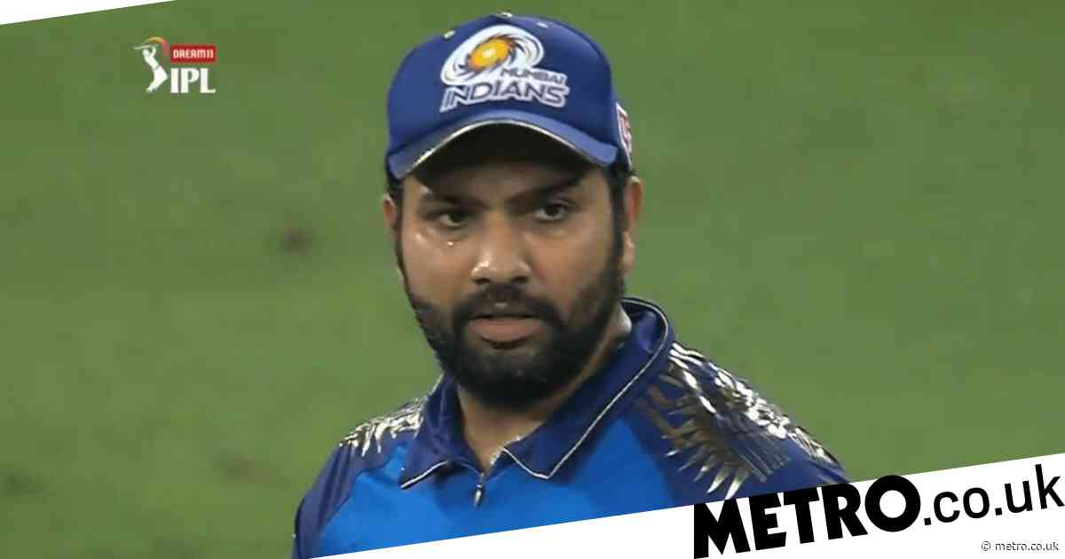 Virat Kohli and Rohit Sharma react as Royal Challengers Bangalore beat Mumbai Indians in thrilling IPL super over