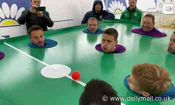 Friends play bizarre game of table football with their heads in Turkey