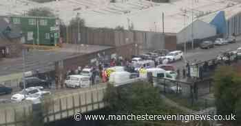 'Large gathering' at scene of fatal collision in Salford - updates