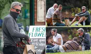 Sam Newman spotted 12km from his house having a picnic in a park