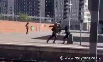 Blade-wielding youth attacks rival in train station platform knife fight