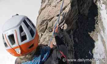 Climbers make their way across a narrow Alpine ridge at 11,800ftin France