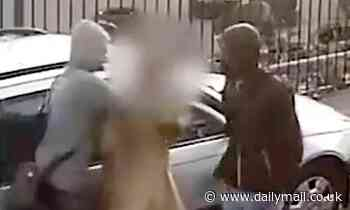 Thugs batter a man to the ground before fleeing with his cash that had spilled across pavement