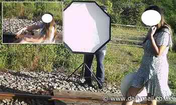 Model posing on train line for a PHOTOSHOOT is among trespassers caught on camera at level crossing
