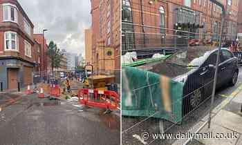 Workmen surround Kia with 6ft metal fences after driver leaves hatchback in roadworks