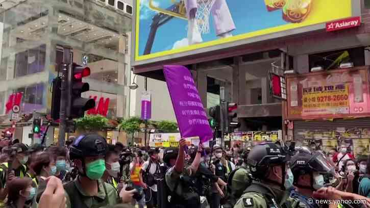 HK police arrest dozens in China national day protest