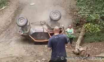 Terrifying moment off-road buggy barrel rolls back down a huge hill narrowly missing spectators