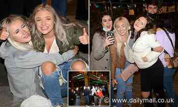 Last chance to mingle: Revellers enjoy night out on the town 24 hours before new ban on mixing