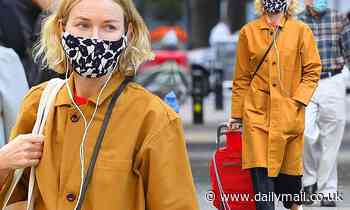 Naomi Watts looks stylish in a yellow coat and face mask as she goes for a stroll in New York - Daily Mail