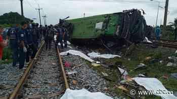 Bus-train collision in Thailand leaves 20 dead