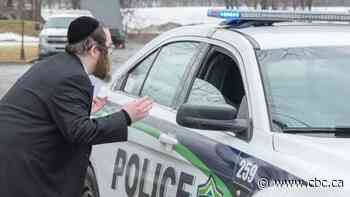 Police intervene after hundreds gather in Montreal suburb to celebrate Jewish holiday